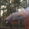 Guy jumps out of a flaming SUV