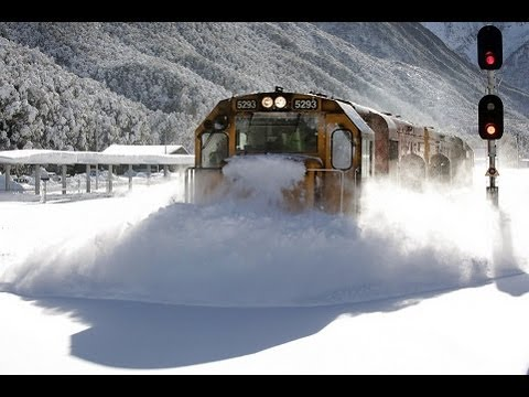 Train plowing through snow