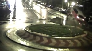 Car flies over roundabout like in movies