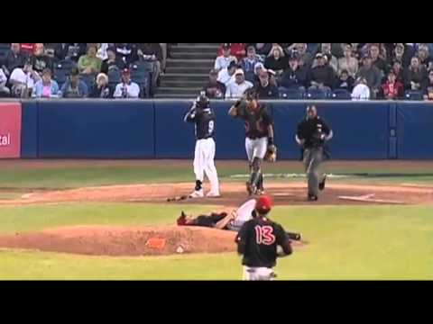 Pitcher saves face from hit