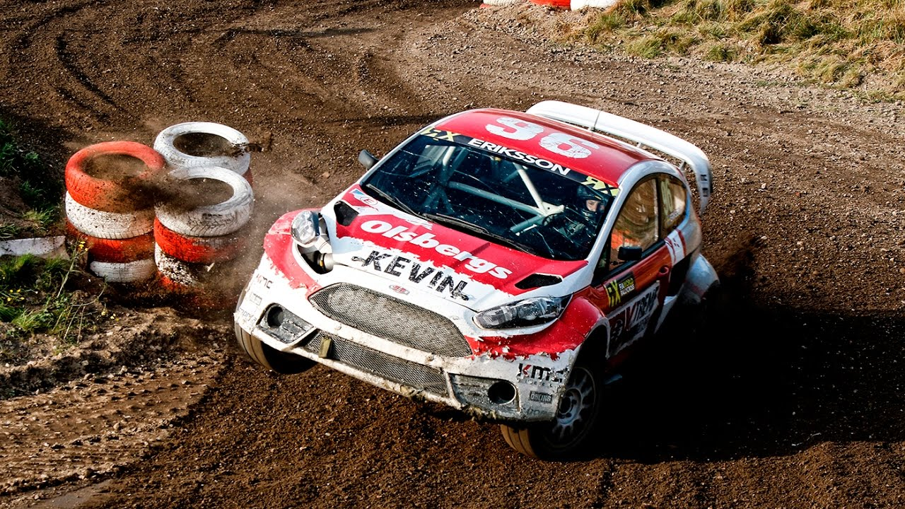 Rally car driver drifts into first place like he's playing a video game