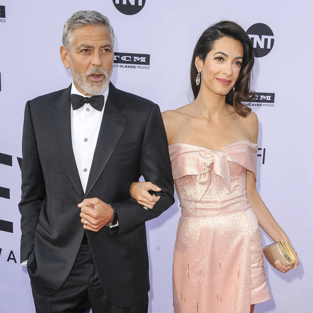 George and Amal Clooney considering adoption - The Tango